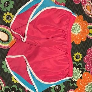 Pink and turquoise workout shorts
